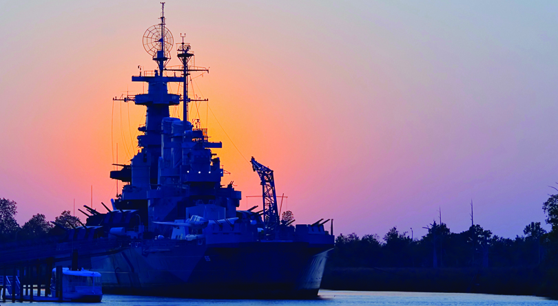 The Battleship North Carolina guards Wilmington NC's downtown waterfront.