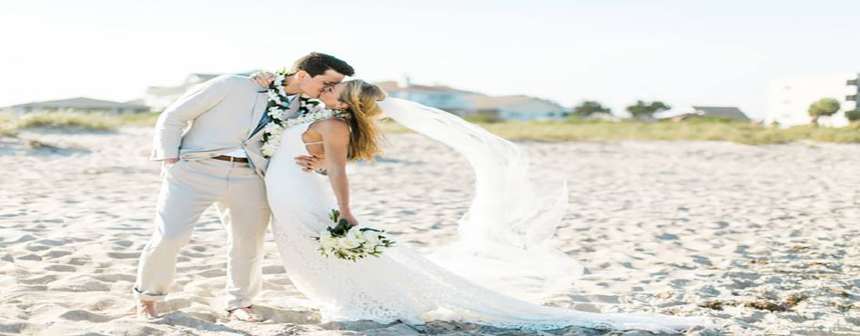 oceanic wedding kiss waterfront sand wrightsville beach copy