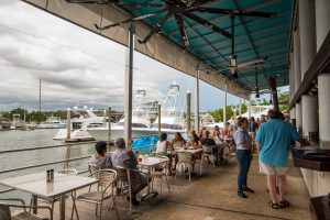 Outdoor seating on the water at Bluewater Grill